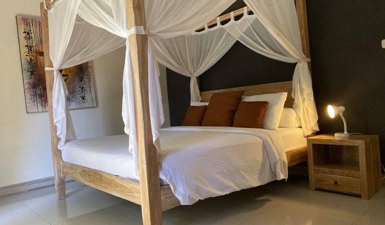 bed with canopy frame and curtains