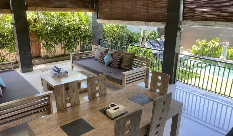 balcony area with tables and chairs