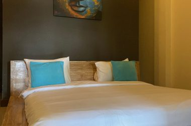 wooden bed with white beddings and