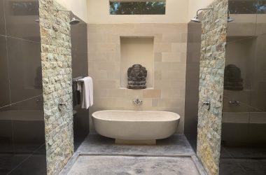 bath tub with 2 showers
